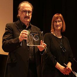 Immagine della premiazione del maerstro Pino Donaggio